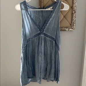Sleeveless blouse. Entro brand. Buttons on back.